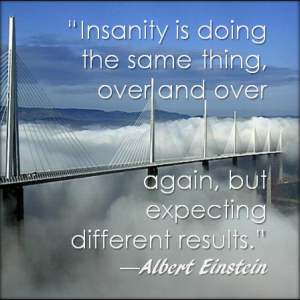Image of bridge with cloud cover with Einstein's quote Insanity is doing the same thing over and over again and expecting different results