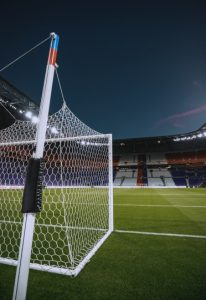 corner of football goal viewed from the back
